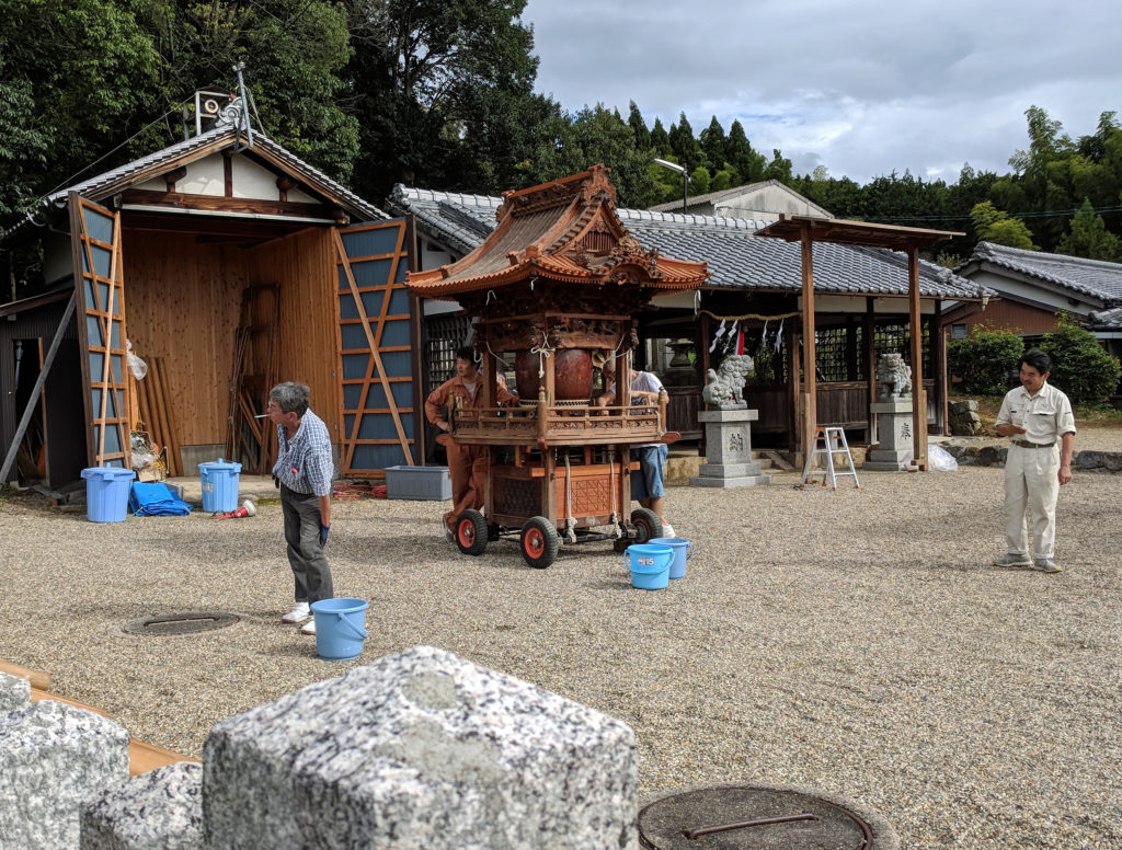 Traveling shrine being prepared for ceremony